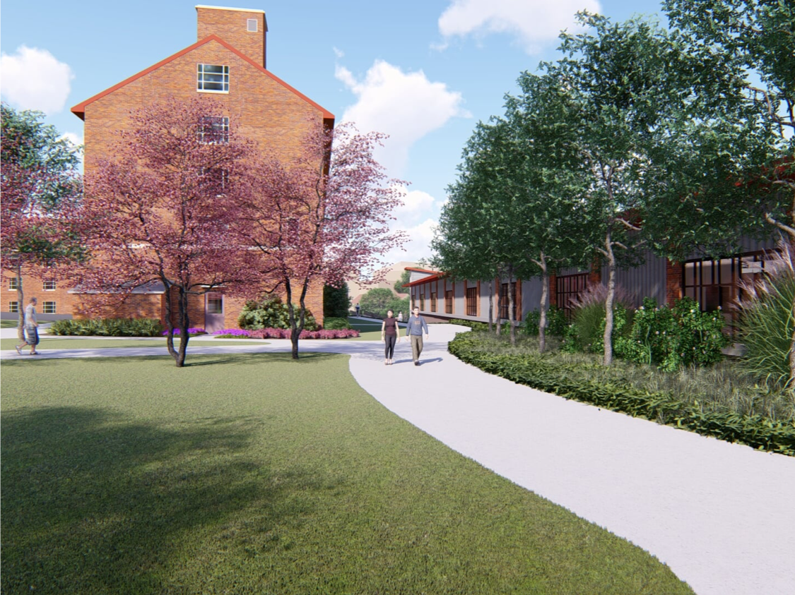 rendering showing the pathway between the new HWC and Memorial Hall, that will connect with the bridge over the ravine that leads to the Walter K Chess Center