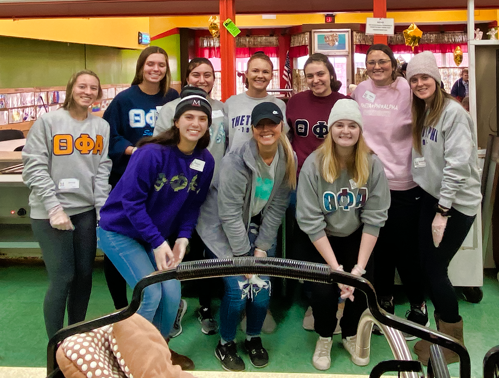 sorority members volunteer at Christ's Table in Zanesville