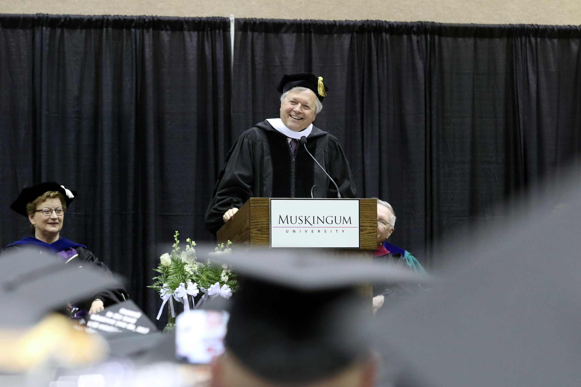 Dan Hughes speaking to the graduates