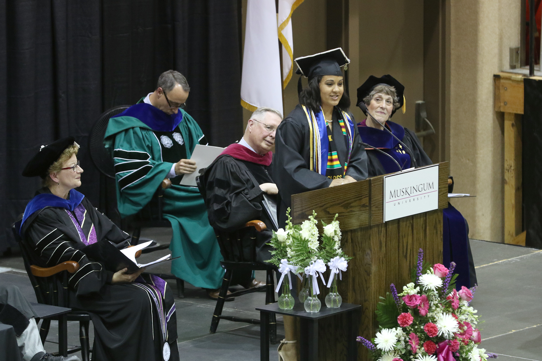 Kayla Wilkerson speaking to the graduates