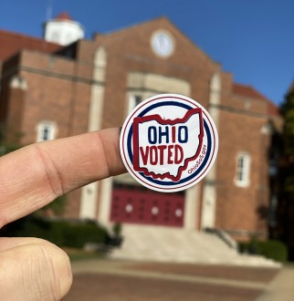 voting sticker in front of John Glenn Gym