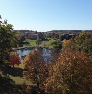 aerial shot of fall on campus showing trees with orange leaves