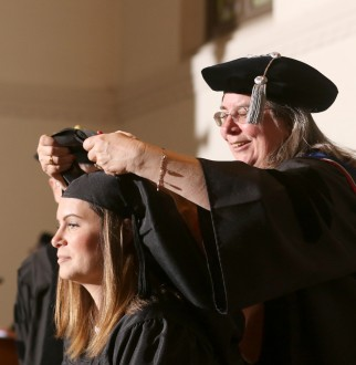 Student being hooded