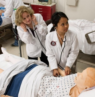 nursing student and instructor examining a practice dummy patient in the Muskingum Nursing Lab