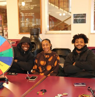 African American Students hosting a BHM trivia Table in the Bait shop on campus during Lunch Hour
