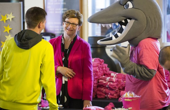 susan hasseler talking to a student with the Muskie Mascot beside her