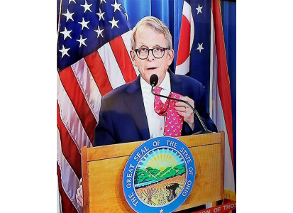 governor mike dewine showing off his Muskie tie before his press conference