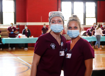 nursing students posing in front of the flu shot clinic