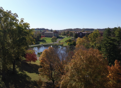 fall shot of campus trees and lake